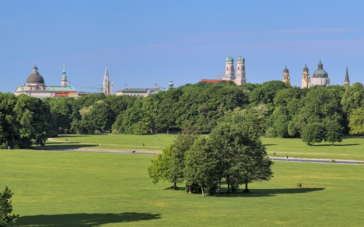 Munich, Germany - May 30, 2017: Munich skyline, view from Monopteros temple in Englischer Garten (English Garden) in summer morning, Germany. On the image shown: dome of Bavarian State Chancellery, tower of St. Peter Church, tower of New Town Hall, Frauenkirche (Cathedral of Our Lady), Theatinerkirche (Theatine Church of St. Cajetan).