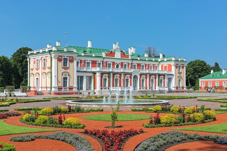 Tallinn, Estonia - July 27, 2016: Kadriorg Palace and flower garden with fountain. Kadriorg Palace is a Petrine Baroque palace built for Catherine I of Russia by Peter the Great in 1718-1727. The palace currently houses the Kadriorg Art Museum, a branch of the Art Museum of Estonia.