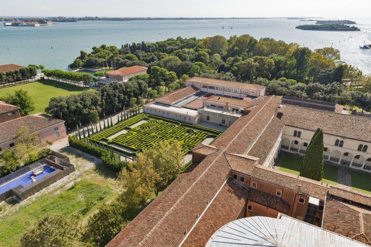 Aerial view over Church of San Giorgio Maggiore, Cultural center Fondazione Giorgio Cini and Labyrinth Borges. Venice, Italy.
