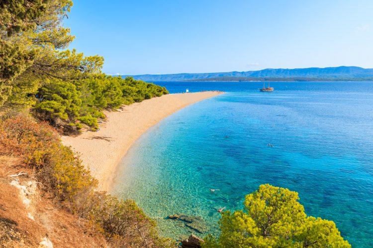 View of famous Zlatni Rat beach with beautiful sea water in Bol town, Brac island, Croatia