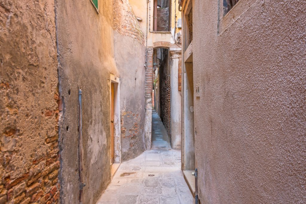 The narrowest street in the city of Venice is Calle varisco.