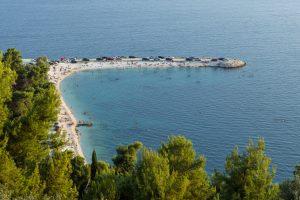 Popular beach at the Marjan peninsula in Split, Croatia, viewed from above.