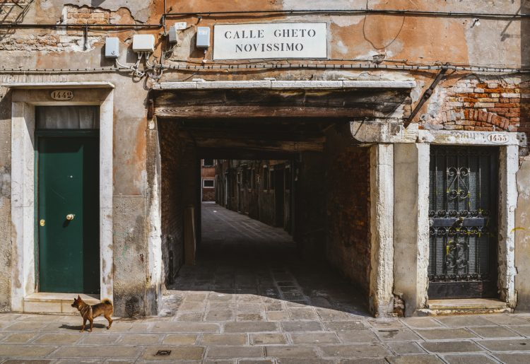 Venice, Italy - March 28, 2018: Entrance to an ancient alleyway in the traditional Jewish ghetto of Venice located in the Cannaregio district. Calle Gheto Novissimo in English means New Ghetto Street