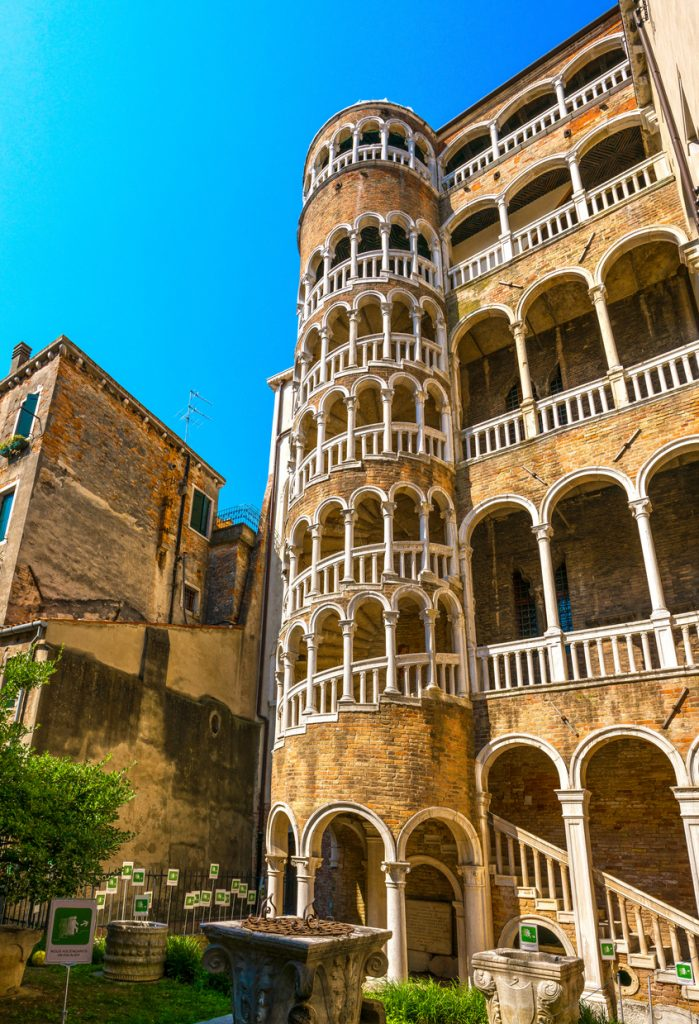 VENICE / ITALY - JUNE 20, 2017: View of Palazzo Contarini del Bovolo with multi arch spiral staircase. The staircase leads to an arcade, providing an impressive view of the city.