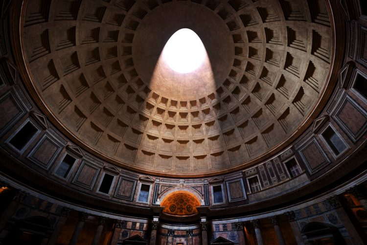 Inside the Pantheon in Rome, Italy. Light shining through a famous central opening, oculus in the ceiling