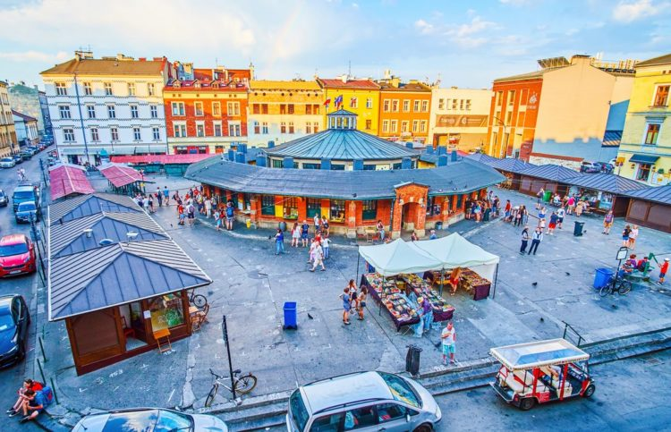 Krakow, Poland - June 21, 2018: The rainbow in the sky over the New Square (Plac Nowy) in Kazimierz Jewish Quarter, famous for its flea market and historical objects, on June 21 in Krakow.