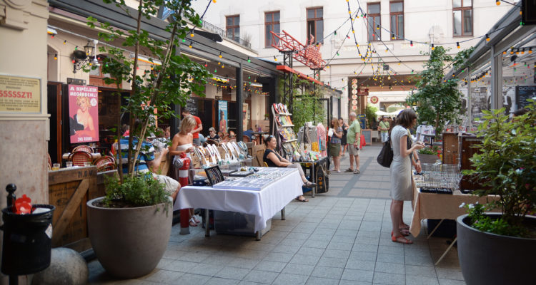 Budapest, Hungary - July 12, 2015: People shopping at Gozsdu Udvar pedestrian gallery in Budapest, small flea market area.