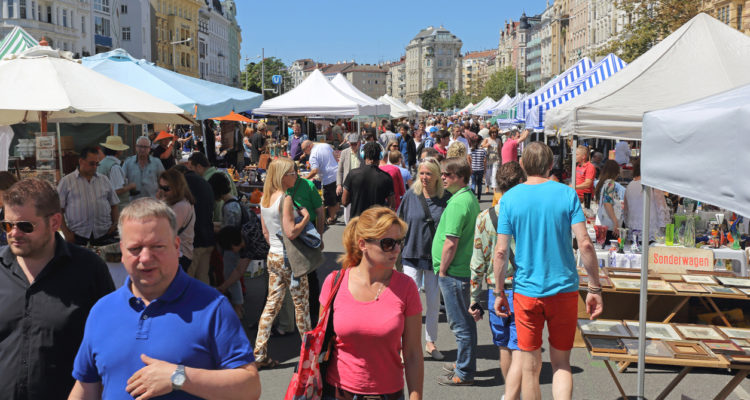 VIENNA, AUSTRIA - JULY 11, 2015: People Shopping at Naschmarkt Saturday Flea Market in Vienna, Austria.