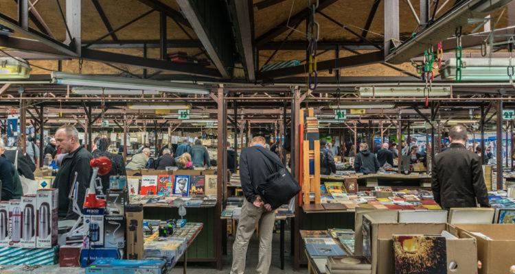 Krakow, Poland - September 21, 2018: Polish looking for Cheap Books at Krakow's Unitarg plac targowy flea market.
