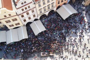 Crowd watching the clock on Prague's Old Town Square