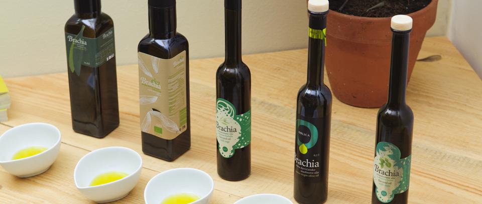 Bottles of Brachia Croatian Olive Oil from the island of Brac, arranged for a tasting.