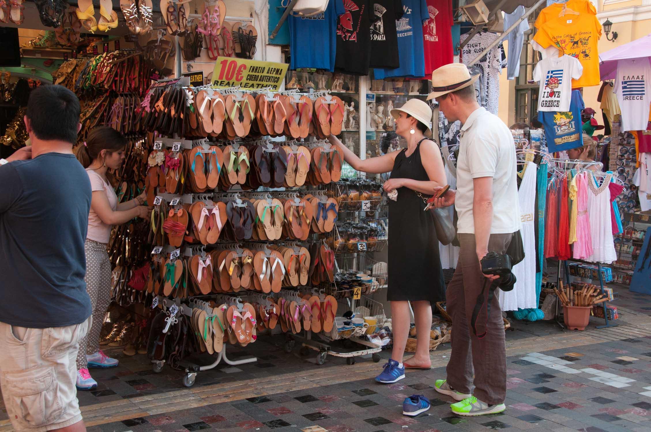 couple shopping for greek leather sandals in Monastiraki Athens
